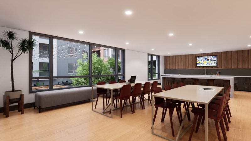 coworking tables and kitchen at broadstone archive apartments